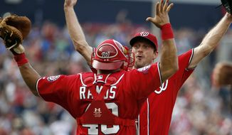 Washington Nationals starting pitcher Max Scherzer, right, celebrates with catcher Wilson Ramos (40) after his no-hitter baseball game against the Pittsburgh Pirates, Saturday, June 20, 2015, in Washington. The Nationals won 6-0. (AP Photo/Alex Brandon)