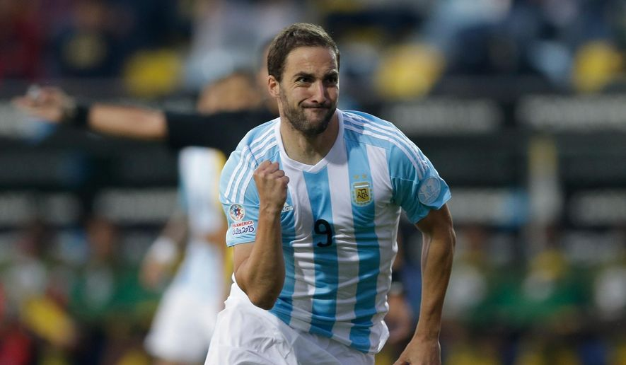 Argentina's Gonzalo Higuain celebrates after scoring against Jamaica  during a Copa America Group B soccer match at the Sausalito Stadium in Vina del Mar, Chile, Saturday, June 20, 2015. (AP Photo/Jorge Saenz)