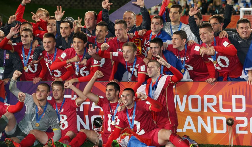 Serbian players celebrate after defeating Brazil 2-1 in extra time to win the U20 soccer World Cup final in Auckland, New Zealand, Saturday, June 20, 2015. (AP Photo/David Rowland)