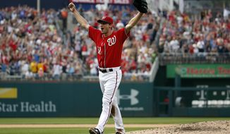 Washington Nationals starting pitcher Max Scherzer celebrates after his no-hitter baseball game against the Pittsburgh Pirates at Nationals Park, Saturday, June 20, 2015, in Washington. The Nationals won 6-0. (AP Photo/Alex Brandon)