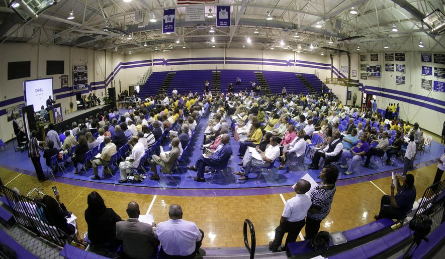 A service honoring Elbert Williams is held in the Haywood County High School gymnasium on Saturday, June 20, 2015, in Brownsville, Tenn. Williams was killed by unknown assailants on June 20, 1940, amid a drive to register black voters. Williams was taken from his home by a group of men led by a police officer, and his body was found later in the Hatchie River. His slaying was never solved. (AP Photo/Mark Humphrey)