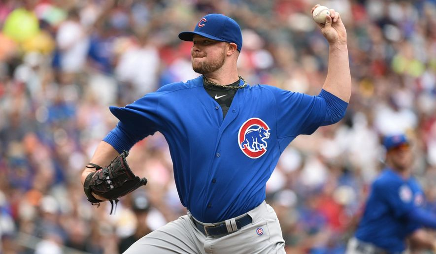 Chicago Cubs starter Jon Lester throws to the Minnesota Twins in the first inning of a baseball game, Saturday, June 20, 2015, in Minneapolis. (AP Photo/Richard Marshall)