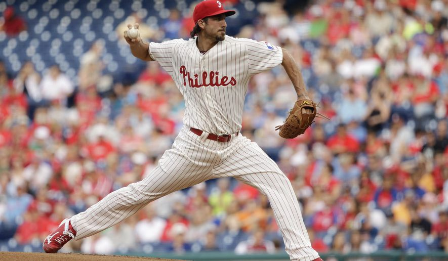 Philadelphia Phillies' Phillippe Aumont pitches during the first inning of a baseball game against the St. Louis Cardinals, Friday, June 19, 2015, in Philadelphia. (AP Photo/Matt Slocum)