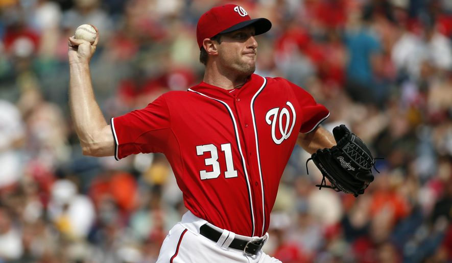 Washington Nationals starting pitcher Max Scherzer (31) throws during the third inning of a baseball game against the Pittsburgh Pirates, Saturday, June 20, 2015, in Washington. (AP Photo/Alex Brandon)
