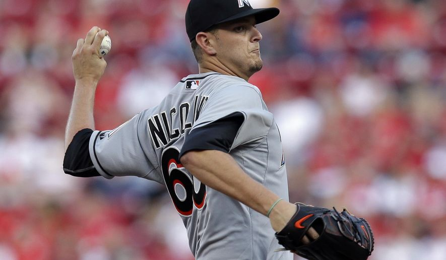 Miami Marlins starting pitcher Justin Nicolino throws in the first inning of a baseball game against the Cincinnati Reds, Saturday, June 20, 2015, in Cincinnati. (AP Photo/John Minchillo)