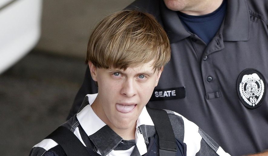 Charleston, S.C., shooting suspect Dylann Storm Roof is escorted from the Cleveland County Courthouse in Shelby, N.C., Thursday, June 18, 2015. Roof is a suspect in the shooting of several people Wednesday night at the historic The Emanuel African Methodist Episcopal Church in Charleston. The current brick Gothic revival edifice, completed in 1891 to replace an earlier building heavily damaged in an earthquake, was a mandatory stop for the likes of Booker T. Washington and the Rev. Martin Luther King Jr. Still, Emanuel was not just a church for the black community.(AP Photo/Chuck Burton) ** FILE **