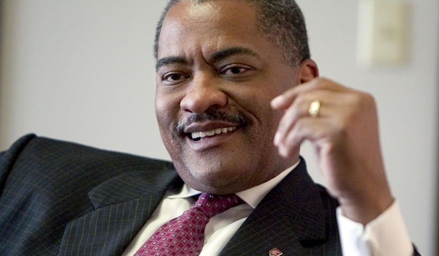 FILE - In this June 18, 2007 file photo, Washington State University president Elson Floyd speaks with a reporter in his office in the French Administration Building on the campus of Washington State University in Pullman, Wash.  Floyd died Saturday, June 20, 2015, at Pullman Regional Hospital, said a school spokeswoman, Kathy Barnard. (AP Photo/Dean Hare, File)