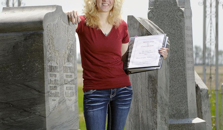 ADVANCE FOR FOR THE WEEKEND OF JUNE 20-21 AND THEREAFTER - In a June 2, 2015 photo, Kellie DeJong stands between the headstones of Albert Breyer and Anna Peters outside St. John's Lutheran Church  near Peirce, Neb. The two were  relatives who were murdered by Peters' former husband Gottlieb Neigenfiend, who was the first man to be executed by the State of Nebraska. (Eric Gregory/The Journal-Star via AP) LOCAL TELEVISION OUT; KOLN-TV OUT; KGIN-TV OUT; KLKN-TV OUT