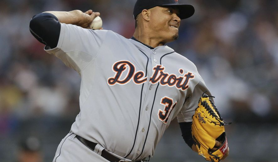 Detroit Tigers' Alfredo Simon delivers a pitch during the first inning of a baseball game against the New York Yankees Saturday, June 20, 2015, at Yankee Stadium in New York. (AP Photo/Frank Franklin II)