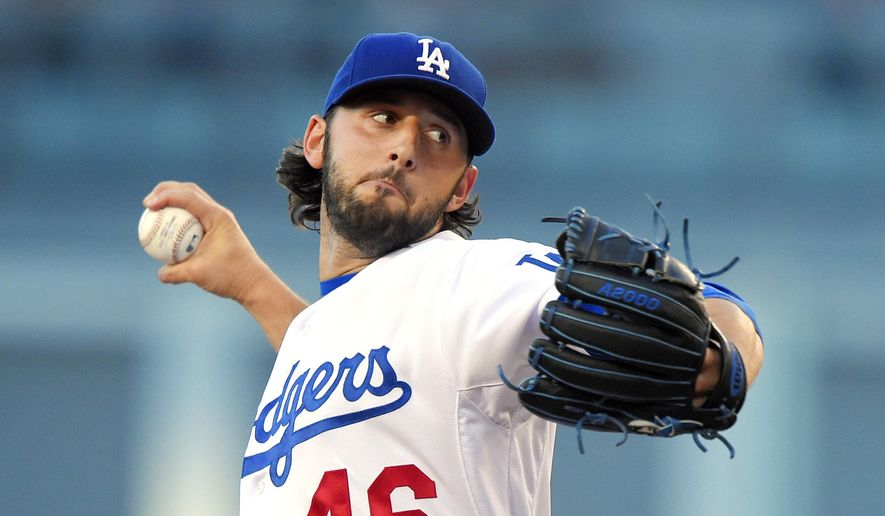 Los Angeles Dodgers starting pitcher Mike Bolsinger throws to the plate during the first inning of a baseball game against the San Francisco Giants, Friday, June 19, 2015, in Los Angeles. (AP Photo/Mark J. Terrill)
