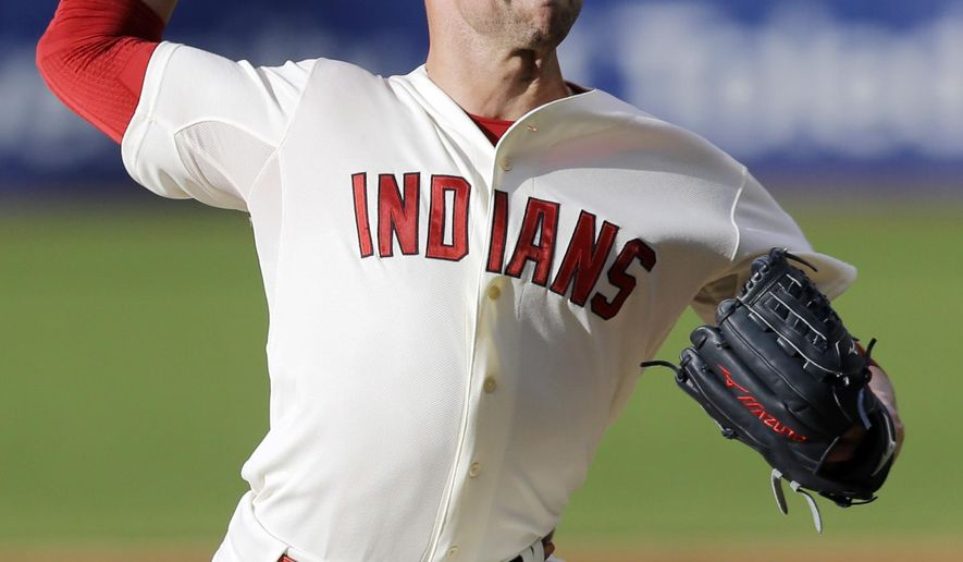 Cleveland Indians starting pitcher Corey Kluber delivers in the first inning of a baseball game against the Tampa Bay Rays, Saturday, June 20, 2015, in Cleveland. (AP Photo/Tony Dejak)