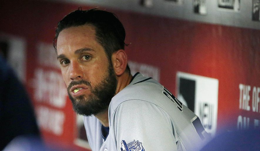 San Diego Padres' James Shields sits in the dugout chewing gum after giving up three runs to the Arizona Diamondbacks during the third inning of a baseball game Friday, June 19, 2015, in Phoenix. (AP Photo/Ross D. Franklin)