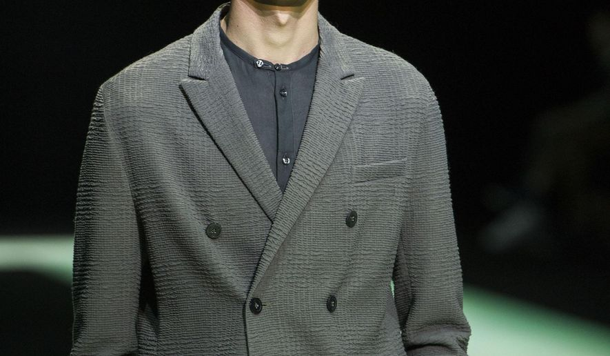 A model wears a creation as part of the Emporio Armani Spring/Summer 2016 men's fashion collection, presented in Milan, Saturday, June 20, 2015. (AP Photo/Giuseppe Aresu)