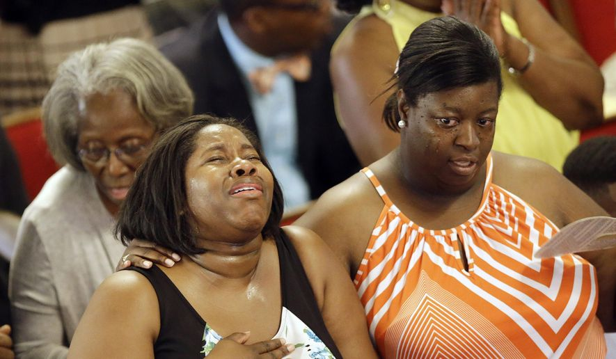 Parishioners sing at the Emanuel A.M.E. Church four days after a mass shooting that claimed the lives of its pastor and eight others on Sunday, June 21, 2015, in Charleston, S.C. (AP Photo/David Goldman, Pool)