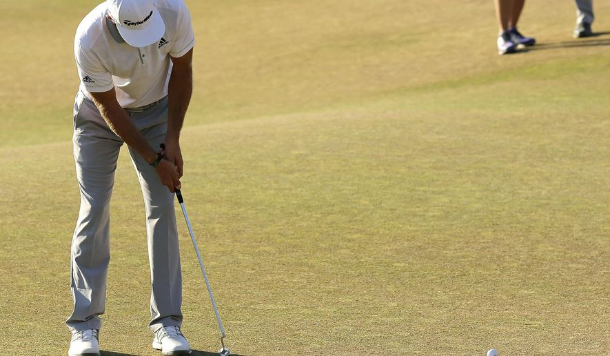 Dustin Johnson three putts the 18th hole during the final round of the U.S. Open golf tournament at Chambers Bay on Sunday, June 21, 2015 in University Place, Wash. (AP Photo/Lenny Ignelzi)