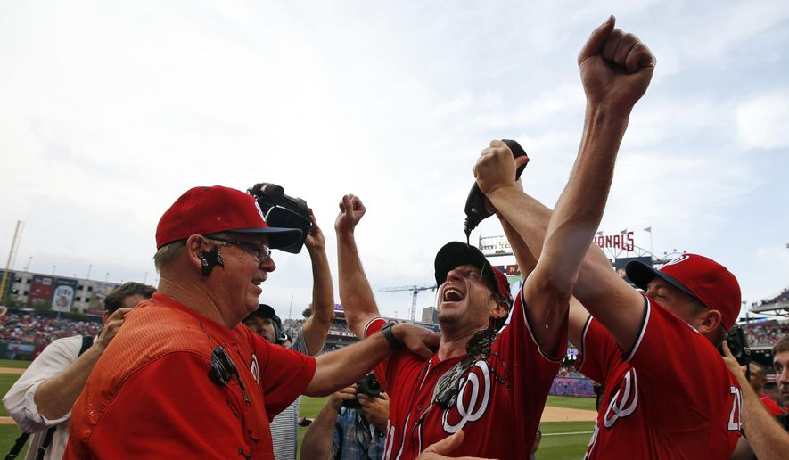 Washington Nationals' Jordan Zimmermann, right, douses starting pitcher Max Scherzer, center, with chocolate syrup as Scherzer celebrates with pitching coach Steve McCatty, left, after Scherzer's no-hitter baseball game against the Pittsburgh Pirates at Nationals Park, Saturday, June 20, 2015, in Washington. The Nationals won 6-0. (AP Photo/Alex Brandon)