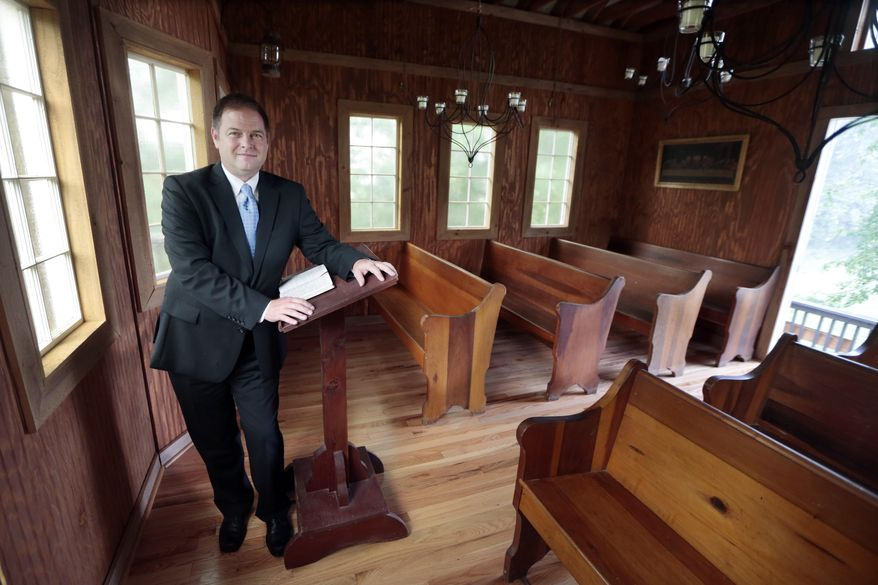 In this June 19, 2015, photo, Pastor Greg Bullard is shown in his chapel in Madison, Tenn. Bullard intends to perform same-sex weddings in the chapel if the U.S. Supreme Court lifts the state's gay marriage ban. (AP Photo/Mark Humphrey)
