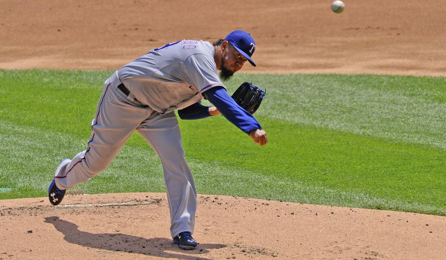 Texas Rangers starting pitcher Yovani Gallardo  delivers during the first inning of a baseball game against the Chicago White Sox on Sunday, June 21, 2015, in Chicago. (AP Photo/Matt Marton)