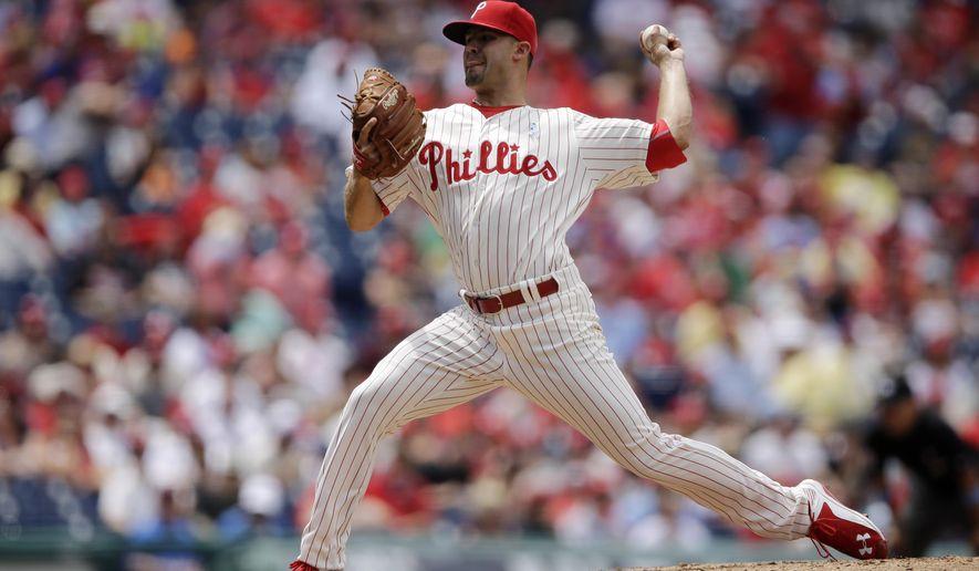 Philadelphia Phillies' Adam Morgan pitches during the third inning of a baseball game, Sunday, June 21, 2015, in Philadelphia. (AP Photo/Matt Slocum)