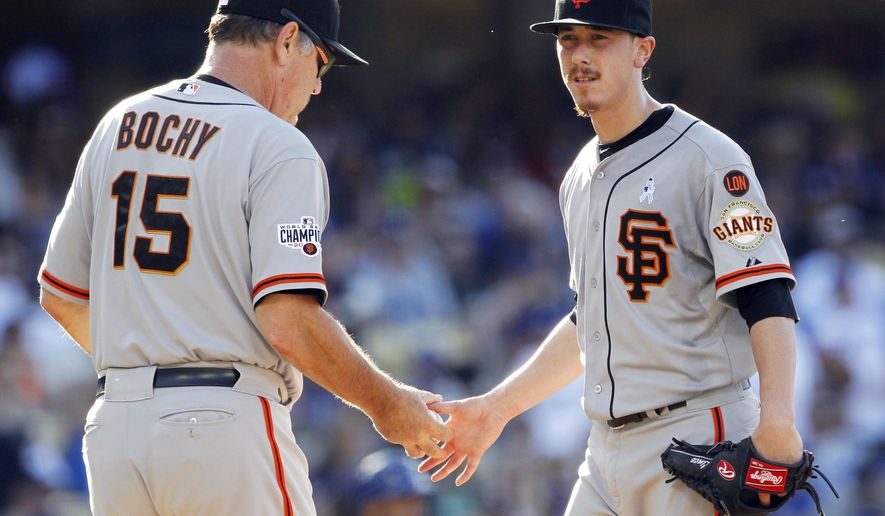 San Francisco Giants starting pitcher Tim Lincecum, right, gives the baseball to manager Bruce Bochy after giving up five runs to the Los Angeles Dodgers, four during the second inning of a baseball game in Los Angeles, Sunday, June 21, 2015. (AP Photo/Alex Gallardo)