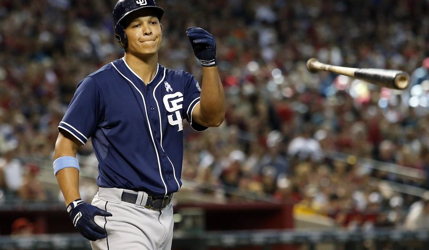 San Diego Padres Will Venable reacts after striking out in the eighth inning of a baseball game against the Arizona Diamondbacks, Sunday, June 21, 2015, in Phoenix. (AP Photo/Rick Scuteri)