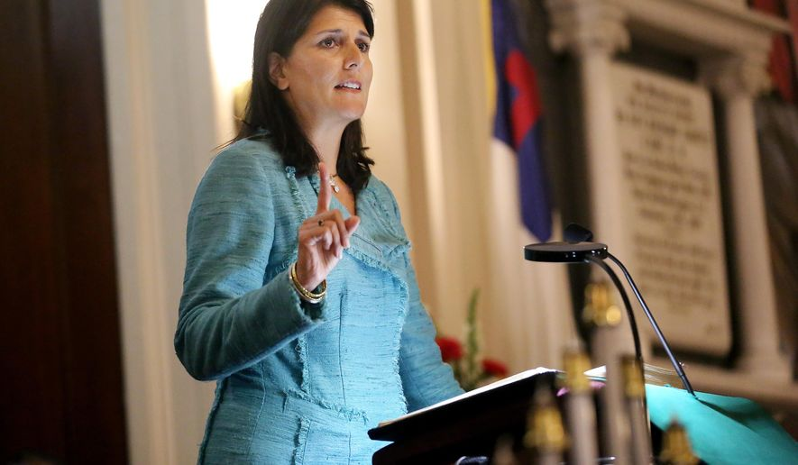 FILE - In this June 18, 2015, file photo, South Carolina Gov. Nikki Haley addresses a full church during a prayer vigil held at Morris Brown AME Church for the victims of the shooting at Emanuel AME Church in Charleston, S.C. Haley said the shooter who gunned down nine people inside a historic black church in Charleston should be put to death. (Grace Beahm/The Post And Courier via AP, Pool, File)