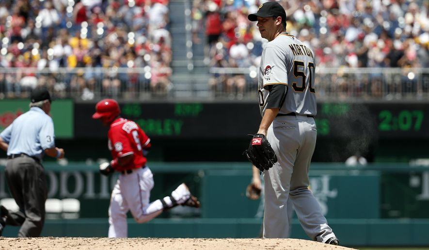 Pittsburgh Pirates starting pitcher Charlie Morton (50) looks on as Washington Nationals' Yunel Escobar (5) runs the bases after hitting a three-run home run during the first inning of a baseball game Sunday, June 21, 2015, in Washington. (AP Photo/Alex Brandon)