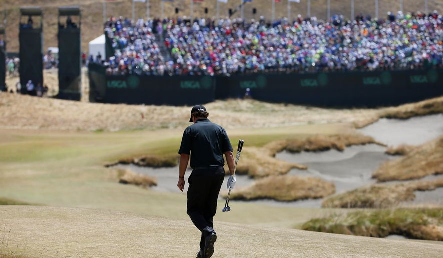 Phil Mickelson walks to 18th green during the final round of the U.S. Open golf tournament at Chambers Bay on Sunday, June 21, 2015 in University Place, Wash. (AP Photo/Matt York)