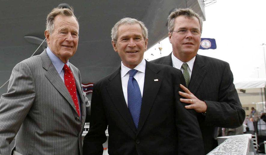 Former Presidents George H.W. Bush and George W. Bush with former Florida Gov. Jeb Bush. (Associated Press) ** FILE **
