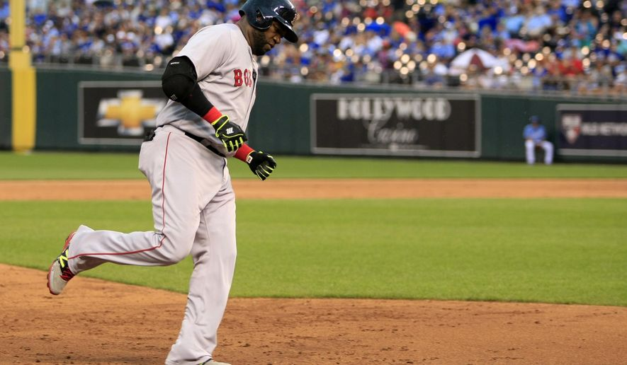 Boston Red Sox designated hitter David Ortiz rounds the bases after hitting a solo home run in the fourth inning of a baseball game against the Kansas City Royals at Kauffman Stadium in Kansas City, Mo., Sunday, June 21, 2015. (AP Photo/Colin E. Braley)