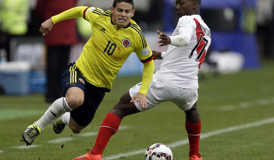 Colombia's James Rodriguez, left, is fouled by Peru's Luis Advincula  during a Copa America Group C soccer match at  the Bicentenario German Becker stadium in  Temuco, Chile, Sunday, June 21, 2015. (AP Photo/Natacha Pisarenko)