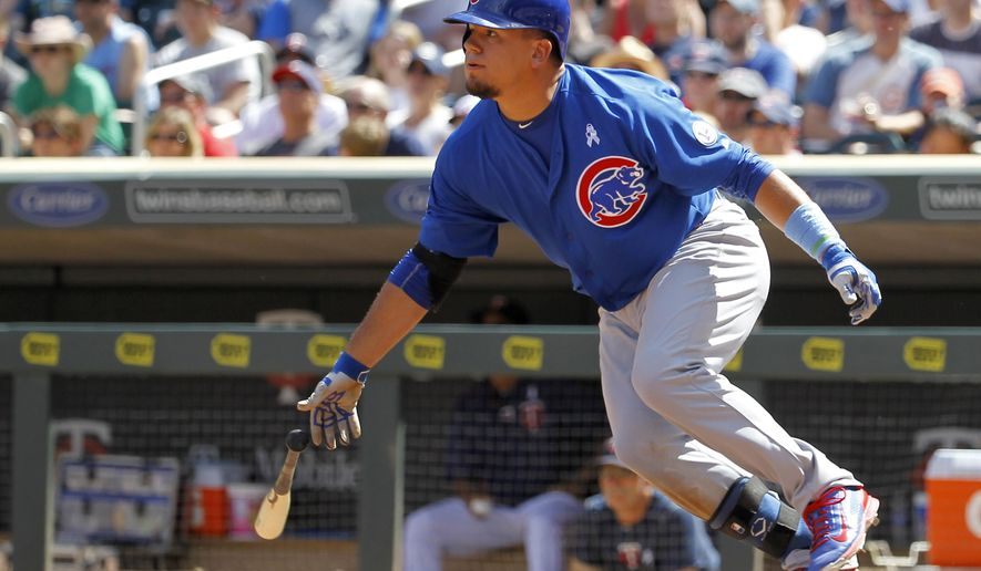 Chicago Cubs designated hitter Kyle Schwarber watches the flight of his two-run single off Minnesota Twins relief pitcher Aaron Thompson during the eighth inning of a baseball game in Minneapolis, Sunday, June 21, 2015. The Cubs won 8-0. (AP Photo/Ann Heisenfelt)