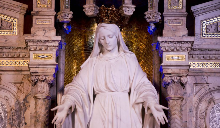 A statue of Our Lady of the Miraculous Medal is shown, Thursday, June 18, 2015, in Philadelphia. The Miraculous Medal shrine, in the residential Germantown neighborhood, features striking stained glass windows and the sculpture dedicated to Mary.   (AP Photo/Matt Rourke)