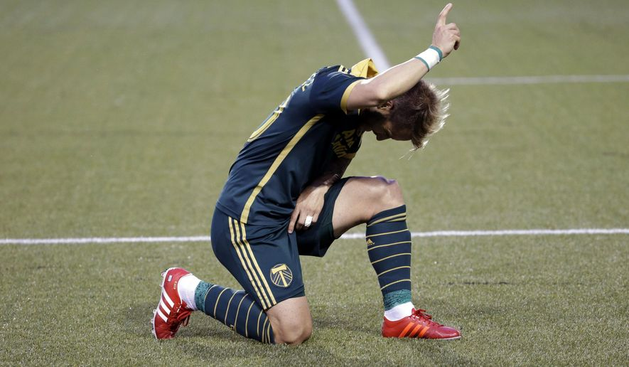 Portland Timbers forward Gaston Fernandez celebrates after scoring on a penalty kick during the second half of an MLS soccer game against the Houston Dynamo in Portland, Ore., Saturday, June 20, 2015. Portland won 2-0. (AP Photo/Don Ryan)