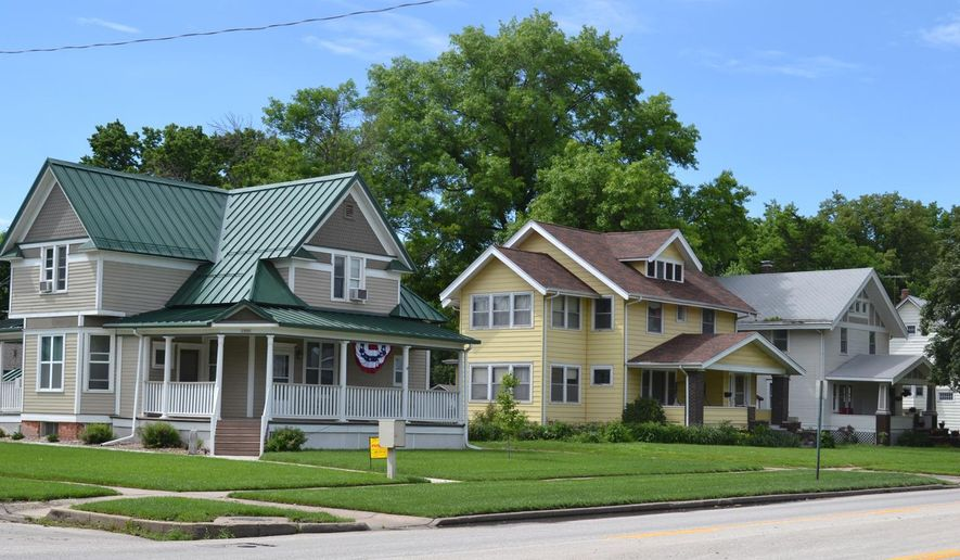 ADVANCE FOR USE SUNDAY, JUNE 21, 2015, AND THEREAFTER- This June 15, 2015, photo shows a variety of home styles in the Broad Street neighborhood of Fremont, Neb. For more than 10 years members of the Fremont community have been working toward getting the North Broad Street District placed on the National Register of Historic Places. In March, their wishes were finally granted. (Tracy Buffington/The Tribune via AP)
