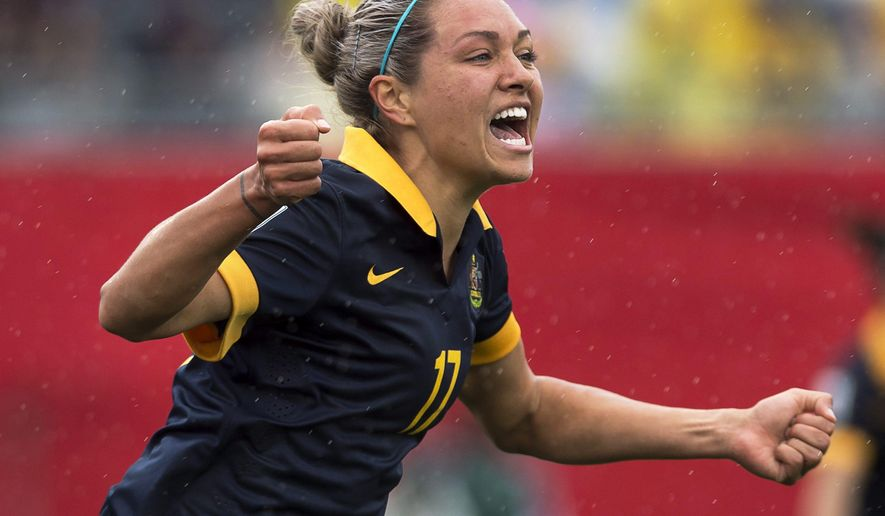 Australia's Kyah Simon celebrates after scoring against Brazil during second-half FIFA Women's World Cup soccer game action in Moncton, New Brunswick, Canada, Sunday, June 21, 2015. (Andrew Vaughan/The Canadian Press via AP) MANDATORY CREDIT