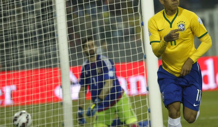 Brazil's Roberto Firmino celebrates after scoring his team's second goal during a Copa America Group C soccer match at the Monumental stadium in Santiago, Chile, Sunday, June 21, 2015. (AP Photo/Silvia Izquierdo)