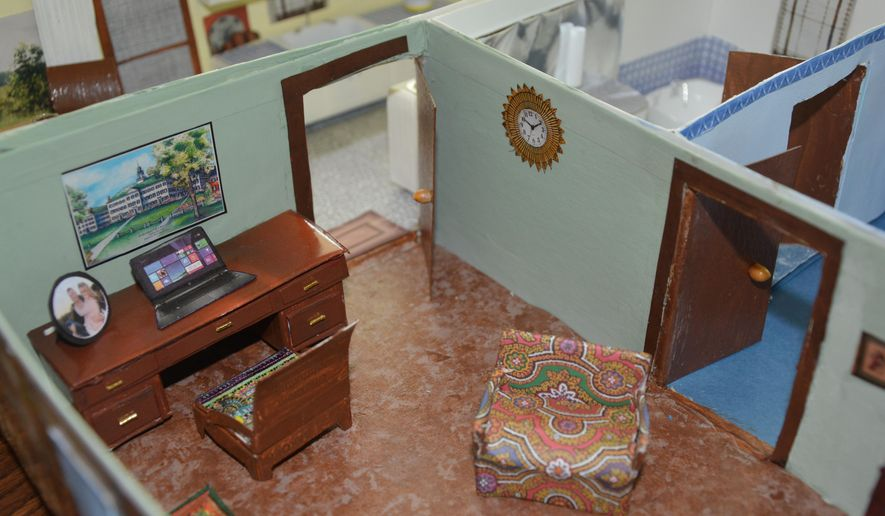 ADVANCED FOR RELEASE SUNDAY, JUNE 21, 2015 Mary Newcomer spent two to three hours every day for months working on her miniature dollhouse made from discarded trash. (Jory Schweers /Beatrice Daily Sun via AP)