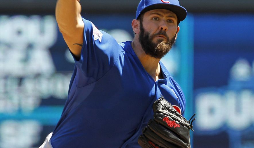 Chicago Cubs starting pitcher Jake Arrieta delivers to the Minnesota Twins during the third inning of a baseball game in Minneapolis, Sunday, June 21, 2015. The Cubs won 8-0. (AP Photo/Ann Heisenfelt)