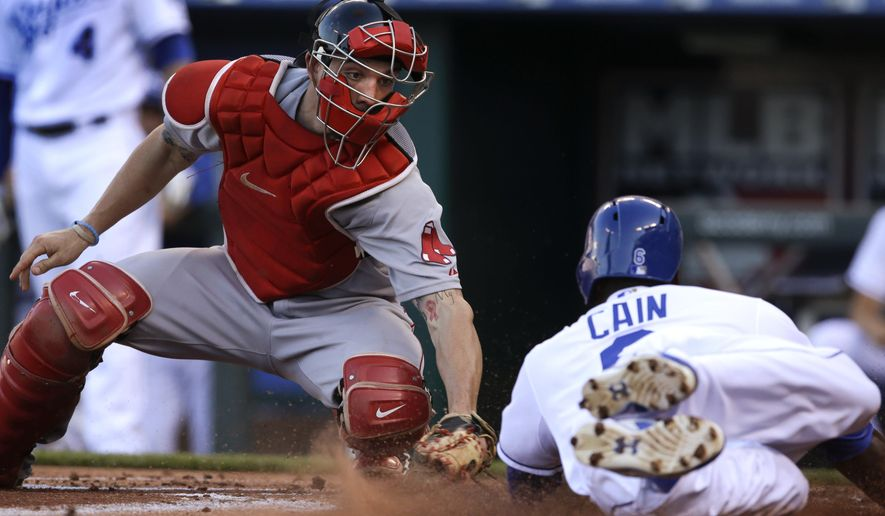 Boston Red Sox catcher Blake Swihart, left, tags out Kansas City Royals' Lorenzo Cain (6) during the first inning of a baseball game at Kauffman Stadium in Kansas City, Mo., Saturday, June 20, 2015. (AP Photo/Orlin Wagner)