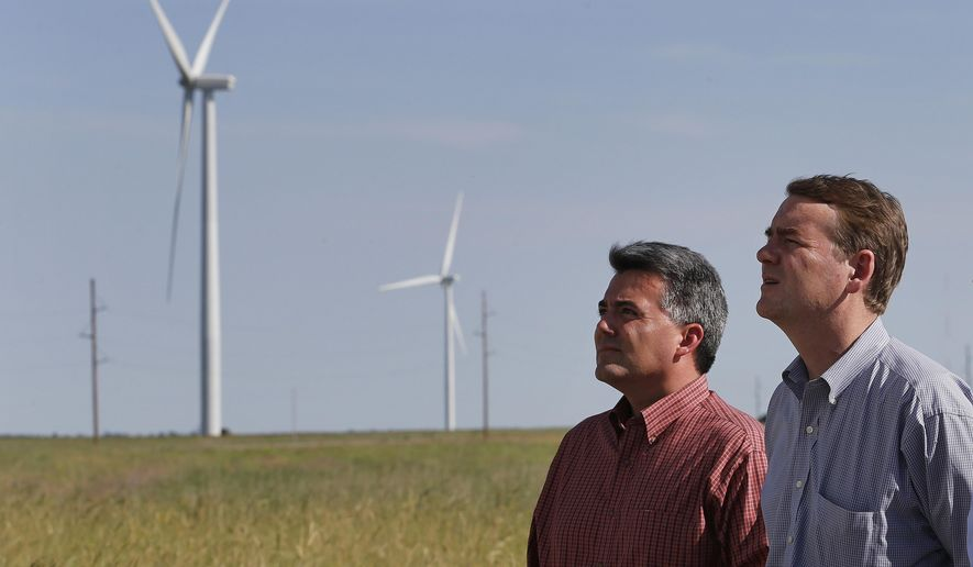 Sen. Michael Bennet, D-Colo., right, and Sen. Cory Gardner, R-Colo., stand together during a tour of the Colorado Highlands Wind farm, in Fleming, northeastern Colorado, Saturday, June 20, 2015. In addition to the wind farm, the two senators spent the day together visiting with wheat farmers. (AP Photo/Brennan Linsley)