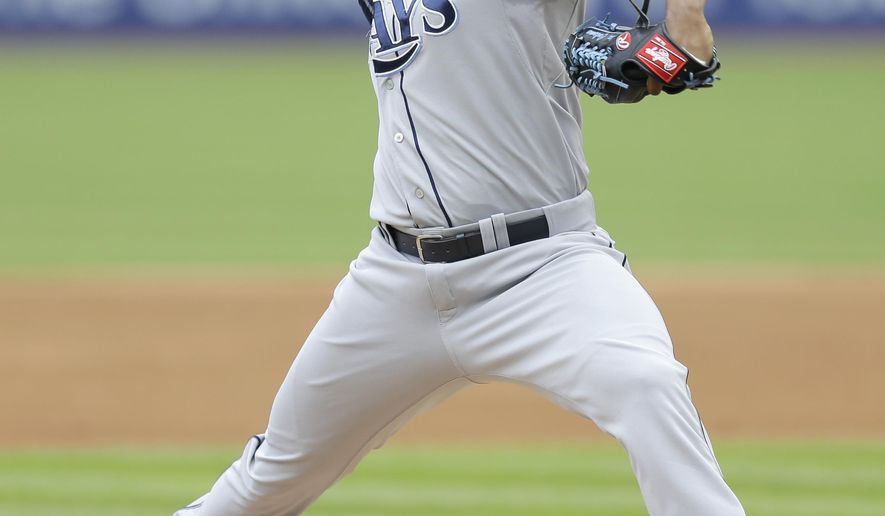 Tampa Bay Rays starting pitcher Alex Colome delivers in the first inning of a baseball game against the Cleveland Indians, Sunday, June 21, 2015, in Cleveland. (AP Photo/Tony Dejak)