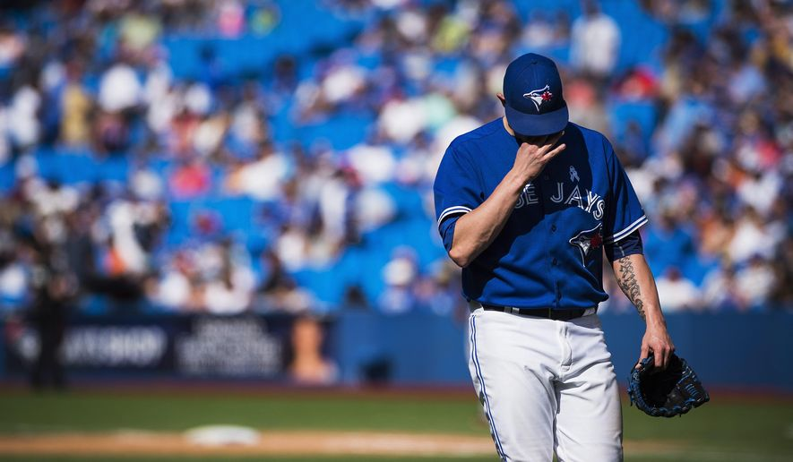 Toronto Blue Jays relief pitcher Brett Cecil is pulled after giving up three runs in the ninth inning of a baseball game against the Baltimore Orioles in Toronto, Sunday, June 21, 2015. (Aaron Vincent Elkaim/The Canadian Press via AP)