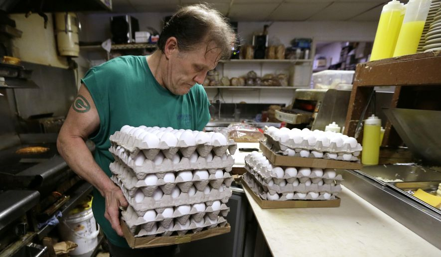Nick Wells puts eggs in a cooler at the Waveland Cafe, Friday, June 19, 2015, in Des Moines, Iowa. Restaurants are struggling to deal with higher egg prices and an inability to get enough eggs and egg products in the midst of a shortage brought about by a bird flu virus that wiped out millions of chickens on commercial farms this spring.(AP Photo/Charlie Neibergall)