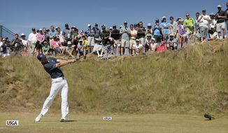 Jordan Spieth watches his tee shot on the sixth hole during the final round of the U.S. Open golf tournament at Chambers Bay on Sunday, June 21, 2015 in University Place, Wash. (AP Photo/Charlie Riedel)