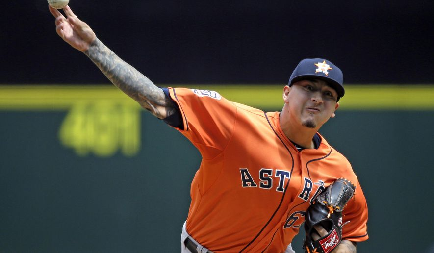 Houston Astros starting pitcher Vincent Velasquez throws against the Seattle Mariners in the first inning of a baseball game Sunday, June 21, 2015, in Seattle. (AP Photo/Elaine Thompson)