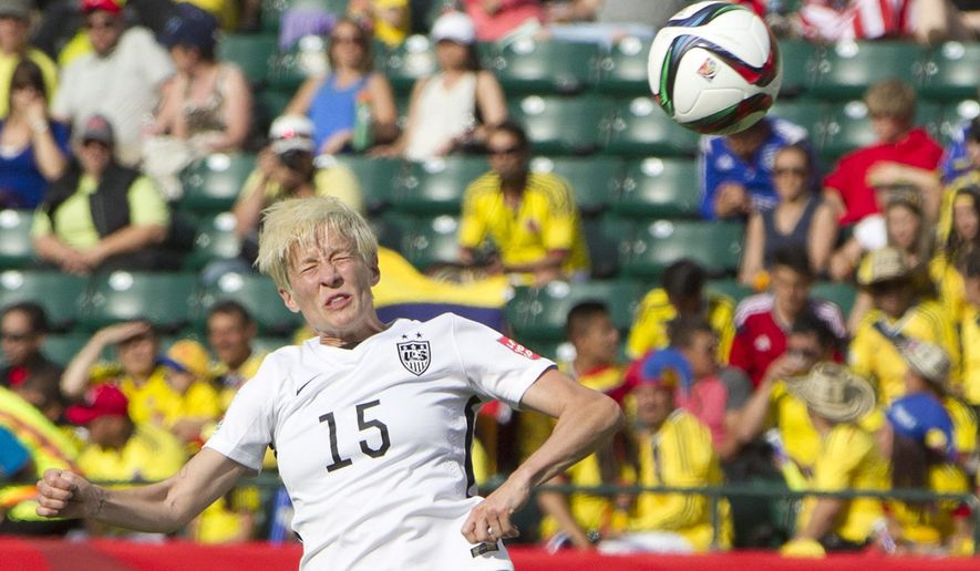 United States' Megan Rapinoe (15) heads the ball against Colombia during first half FIFA Women's World Cup round of 16 soccer action in Edmonton, Alberta, Canada, Monday, June 22, 2015.  (Jason Franson/The Canadian Press via AP) MANDATORY CREDIT