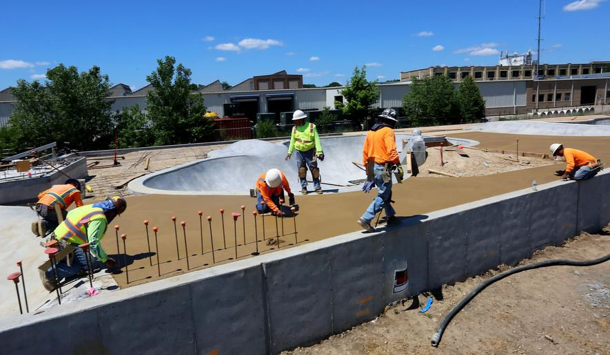 Workers continue construction efforts at skate park under development at Central Park on the near east side of Madison, Wis. Tuesday, June 16, 2015. (John Hart/Wisconsin State Journal via AP)