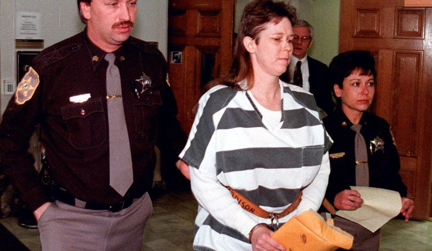 FILE - In this March 10, 1999 file photo, Paula Sims, convicted in the deaths of her two baby daughters in 1990, is led away from a Madison County Courtroom in Edwardsville, Ill. 63-year-old Robert Sims and 27-year-old Randall Sims, the ex-husband and son of Paula Sims, were killed Saturday, June 20, 2015, when their Jeep flipped over the railing of an Interstate 55 overpass in Jackson, Miss. (Jeremy Paschall/The Edwardsville Intelligencer via AP)