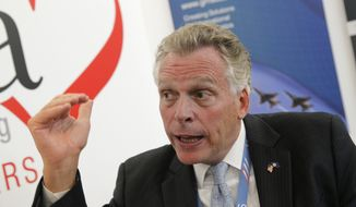 Virginia Gov. Terry McAuliffe speaks during an interview with The Associated Press during the Paris Air Show at Le Bourget airport, north of Paris, on June 16, 2015. (Associated Press) **FILE**
